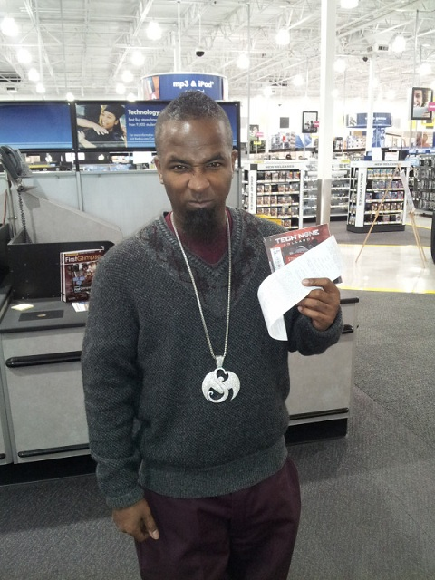 Tech N9ne Poses With His Album And Receipt At Best Buy