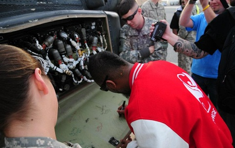 Tech N9ne Signs For The Troops