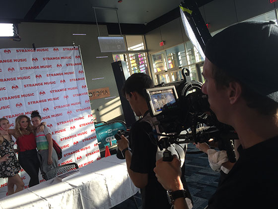 strangeland taking pics of step and repeat